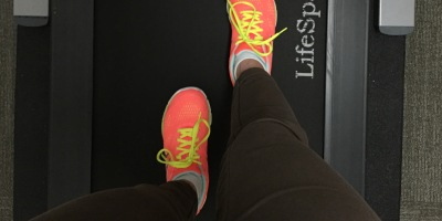 LifeSpan treadmill Desk and neon running shoes.